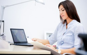 Businesswoman working,  going through paperwork, copy space